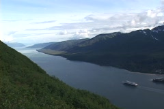 A cruise ship travels in an Alaskan fjords Stock Footage