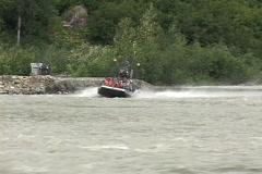 Passengers ride in a fan boat that zips along an Alaskan river. Stock Footage