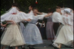 Traditional dancers in Prague dance together in a circle holding hands. Stock Footage