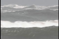 Violent waves whitecap as they roll across the ocean. Stock Footage