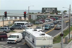 A motor-home turns a tight corner at a busy intersection in Flagler Beach, Stock Footage