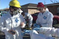 Rescue and relief workers wear respirators  in a neighborhood after Hurricane Stock Footage