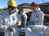 Stock Video Footage of Rescue and relief workers wear respirators  in a neighborhood after Hurricane