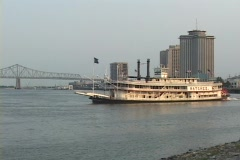 A paddle boat crosses the Mississippi River with New Orleans in the background. Stock Footage