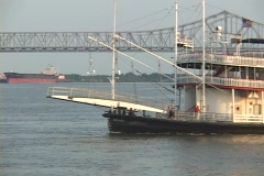 A paddle-boat steamer crosses the Mississippi River with New Orleans in the Stock Footage