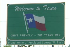 A sign welcomes visitors to Texas, home of George W. Bush. Stock Footage