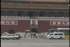 A poster of Mao Tse-tung hangs on a wall in Tiananmen Square. Stock Footage