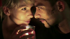 Man and woman blowing out candle Stock Footage
