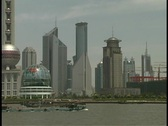 A boat travels on the Huangpu River in Shanghai. Stock Footage