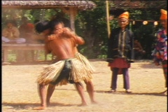 Young men engage in a ritual wrestling match in Indonesia. Stock Footage