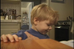 A parent combs a little boy's hair. Stock Footage