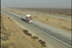 Traffic drives on an interstate in the desert. Stock Footage
