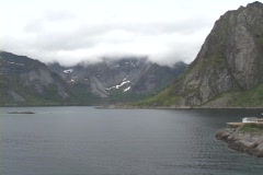 A small fishing village nestles on the edge of a fjord in Norway. Stock Footage