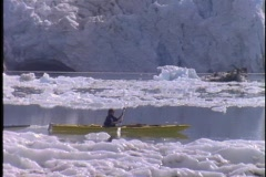 Kayakers paddle through a glacial bay. Stock Footage