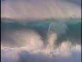 Stock Video Footage of A surfer rides a huge wave then disappears in the surf.