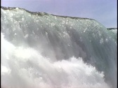 Stock Video Footage of Massive amounts of water thunder over the edge at Niagara Falls.