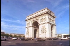 Traffic circles the Arc de Triomphe in Paris. Stock Footage