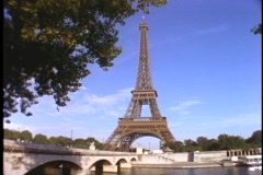 The Eiffel Tower stands high above the city of Paris. - stock footage