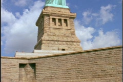 The State of Liberty, in New York City, stands atop a stone tower. Stock Footage