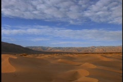 Clouds pass over the vast, sand dunes of the Sahara desert. Stock Footage
