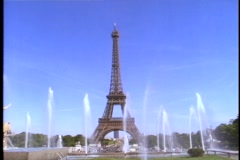 The Eiffel Tower rises high above a pool of fountains. Stock Footage