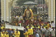 The Dasara festival in Mysore, India features crowds, dancers and decorated Stock Footage