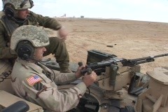 U.S. soldiers fire a  machine gun from an Abrams tank. Stock Footage