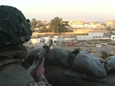 Stock Video Footage of A soldier keeps guard over war-torn Baghdad, Iraq.