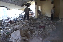 Men shovel rubble in a destroyed building of war-torn Baghdad, Iraq. Stock Footage