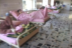Wounded men lie in an Iraqi hospital in Iraq. Stock Footage