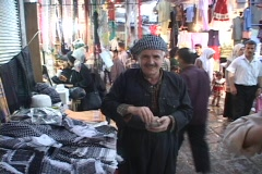 A vendor waves a friendly greeting on a street in Kurdistan, Iraq. Stock Footage
