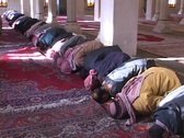 Stock Video Footage of Muslims pray in a mosque of war-torn Baghdad, Iraq.