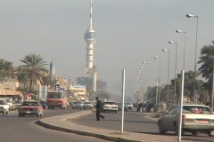 Traffic flows on a busy street in Baghdad, Iraq. Stock Footage