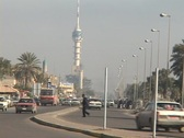 Stock Video Footage of Traffic flows on a busy street in Baghdad, Iraq.