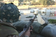 A soldier mans a guard post overlooking Baghdad, Iraq. Stock Footage