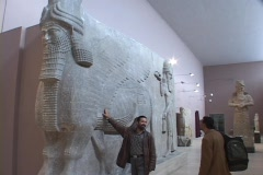 An Iraqi man looks at a Mesopotamian relic in the Baghdad Museum. Stock Footage