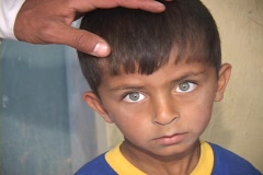 A young Iraqi boy shows the effects of war in his sad face. Stock Footage