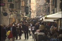 Pedestrians walk through a busy shopping district in Rome, Italy. Stock Footage