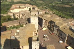 The hills of Tuscany surround the walled village of San Gimignano. - stock footage