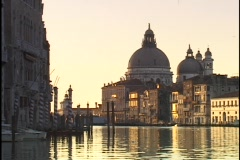 Historic Venetian buildings reflect in the still waters of the Grand Canal in Stock Footage
