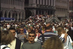 A massive crowd passes over the Rialto bridge in Venice, Italy Stock Footage