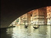 Stock Video Footage of Tourists ride gondolas under the Rialto Bridge on the Grand Canal in Venice,