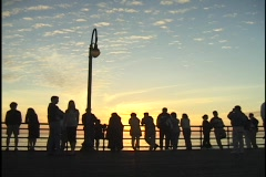 A crowd of people stand on a pier. Stock Footage