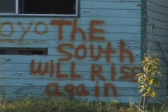 Stock Video Footage of Graffiti on a building reads The South Will Rise Again.