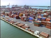 Cargo containers fill a dock in this aerial shot over the Pot of Miami. Stock Footage
