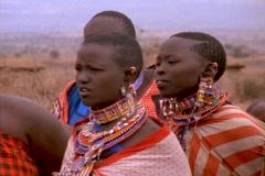 Villagers wear tribal dress in Kenya, Africa. - stock footage