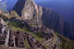 Aerial pan across Inca ruins of Machu Picchu, Andes Mountains, Peru. Stock Footage