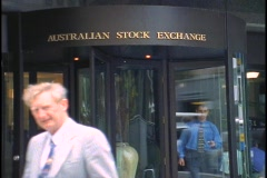 Men walk out of the Australia Stock Exchange building. Stock Footage