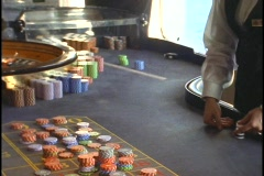 A gaming professional lays chips out on a gaming table. Stock Footage