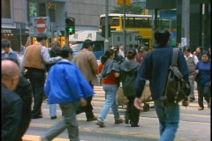 Pedestrians cross a busy intersection in China. - stock footage